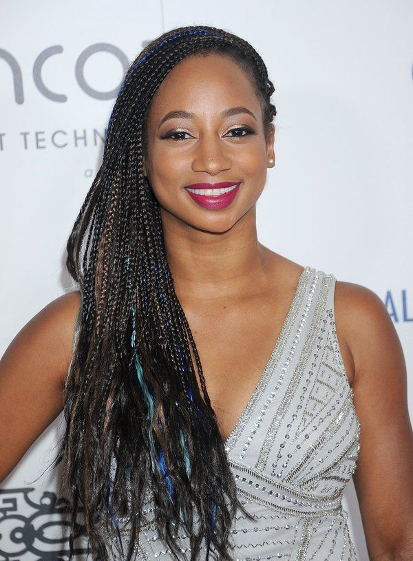 monique coleman showing one side swept box braids
