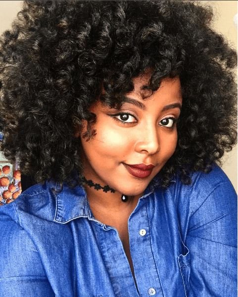 stylish space buns twist out ig journeytowaistlength naturalhairmag