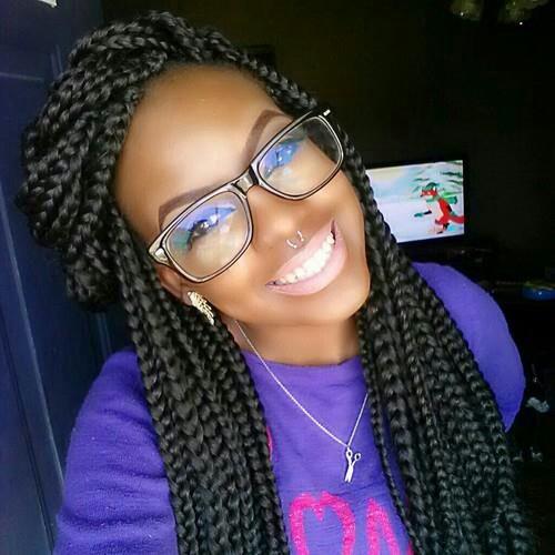 13 box braids and glasses