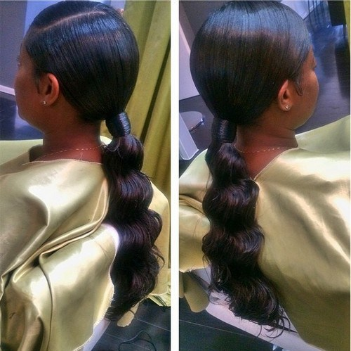 black formal ponytail for relaxed hair