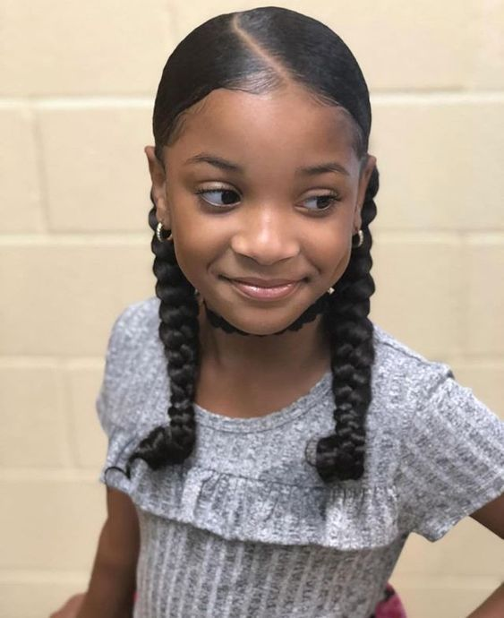 Natural hairstyles for little girls using jumbo hair and braids