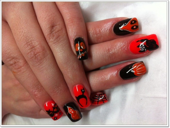 1582543772 22 105 Glitzy Halloween Nails to Rock Your Party Looks