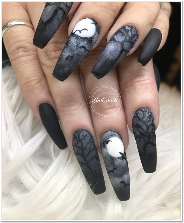 1582543773 865 105 Glitzy Halloween Nails to Rock Your Party Looks