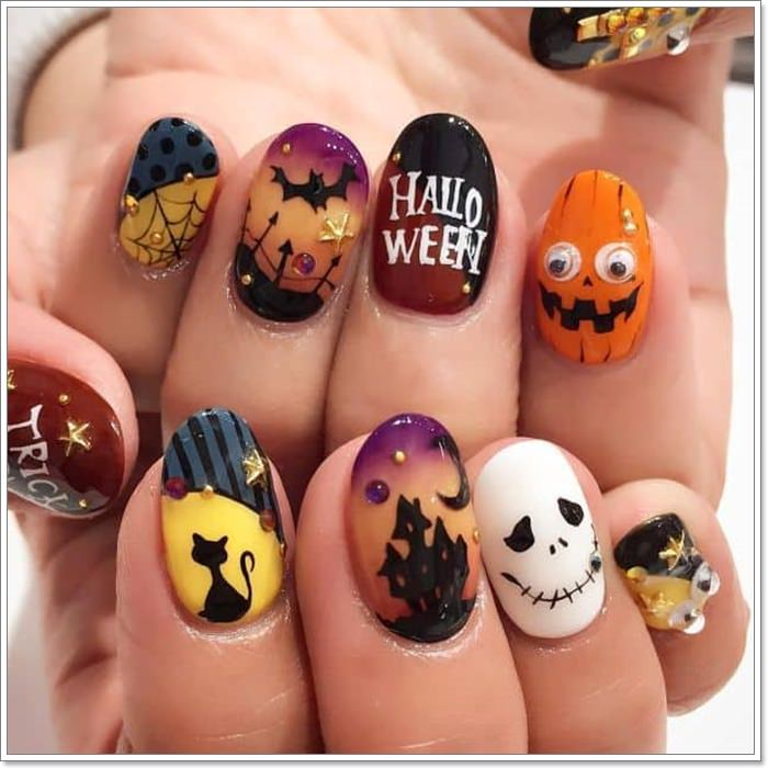 1582543774 278 105 Glitzy Halloween Nails to Rock Your Party Looks