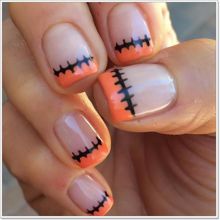 1582543775 328 105 Glitzy Halloween Nails to Rock Your Party Looks