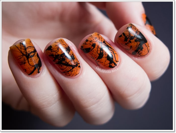 1582543776 581 105 Glitzy Halloween Nails to Rock Your Party Looks