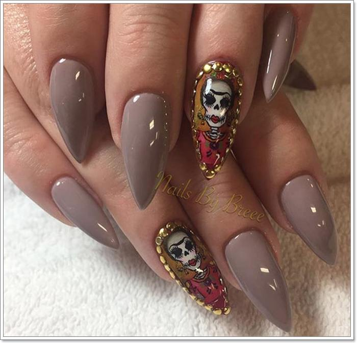 1582543776 798 105 Glitzy Halloween Nails to Rock Your Party Looks