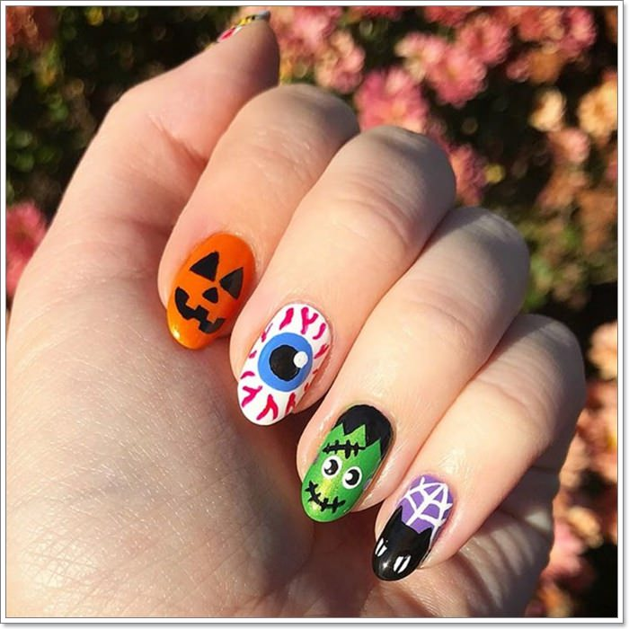 1582543781 445 105 Glitzy Halloween Nails to Rock Your Party Looks