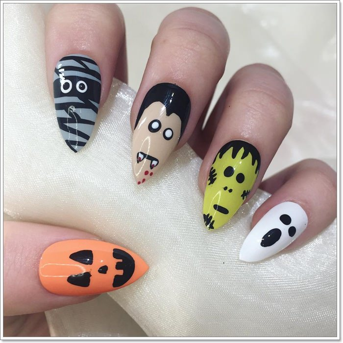 1582543782 916 105 Glitzy Halloween Nails to Rock Your Party Looks