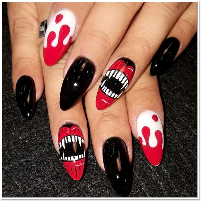 1582543783 73 105 Glitzy Halloween Nails to Rock Your Party Looks