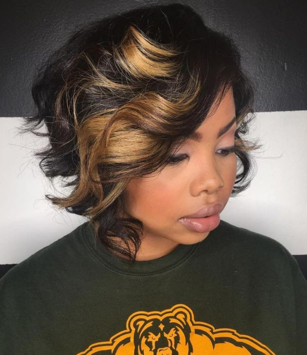 17 black curly bob with chunky highlights