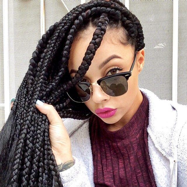 62 box braids and sunglasses