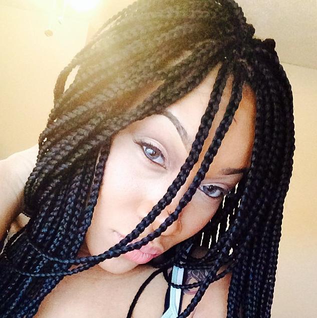 65 grey eyes wearing box braids