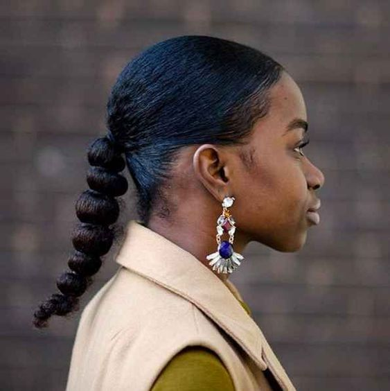 Our moment to channel Sade has finally arrived thanks to this knotted low ponytail